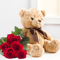 Seven red roses and Teddy Bear
